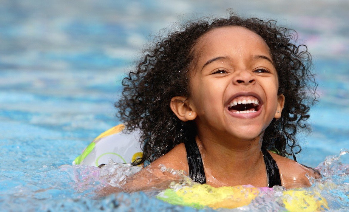 Little girl swimming - Summer Activities to Engage Your Child